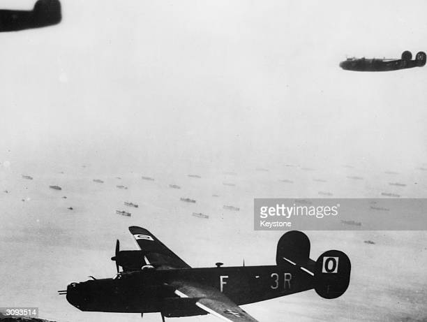 Consolidated B24L Liberators of the 832nd Bomb Squadron 486th Bomb Group US 8th Air Force flying from their base at Sudbury England pass over the...