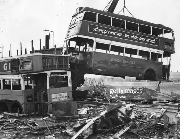 Old London Transport buses being broken for scrap at Rainham in Essex