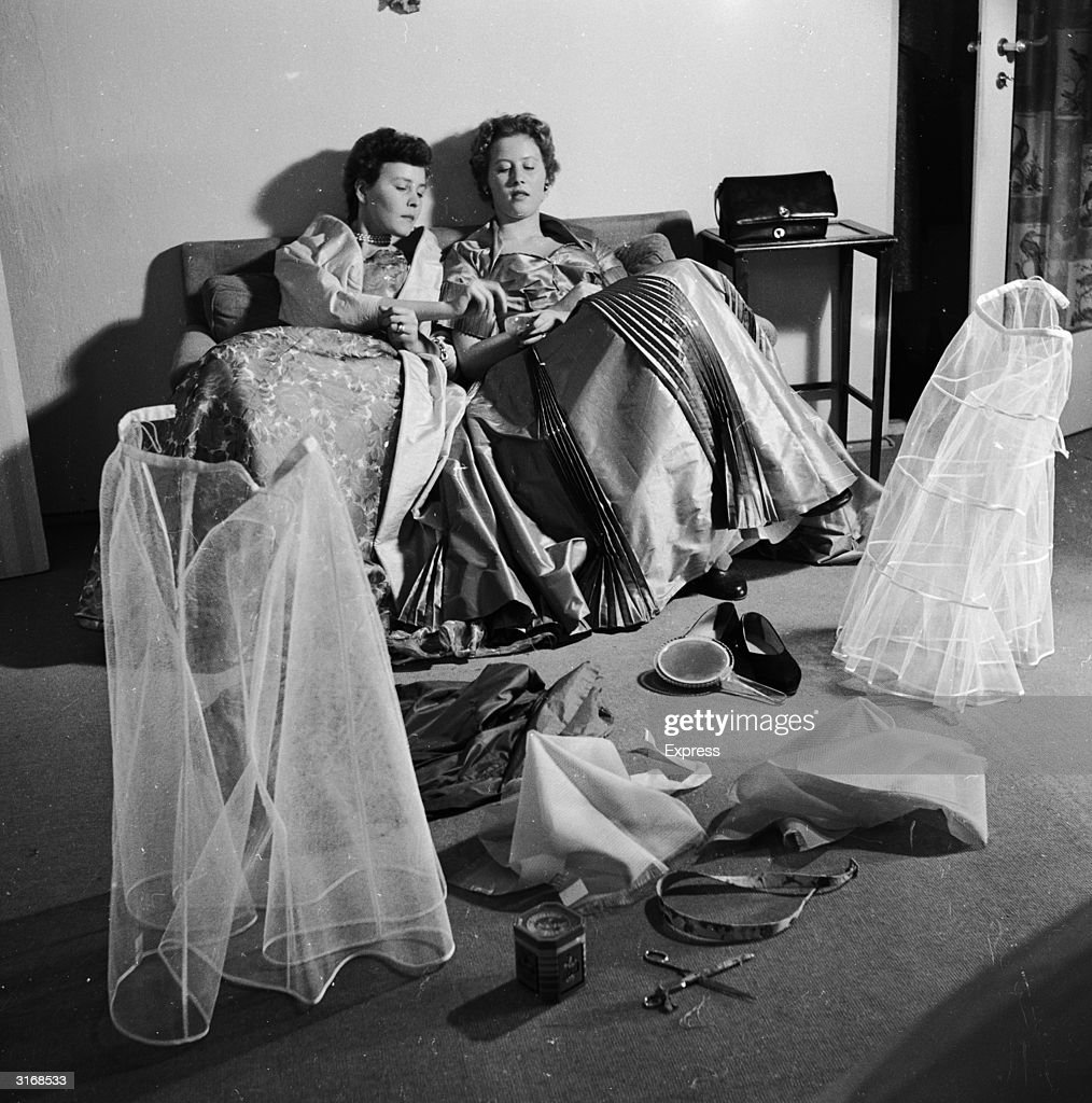 The Duke of Edinburgh's nieces, Princesses Christine and Dorothea of Hesse at a fitting for their dresses to be worn to the coronation of Elizabeth II.