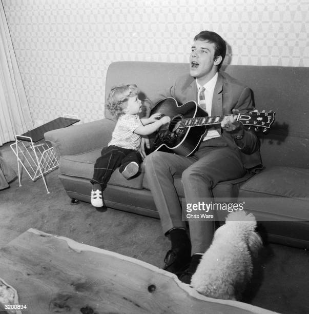 English pop star Marty Wilde gives a private performance at home for his threeyearold daughter Kim