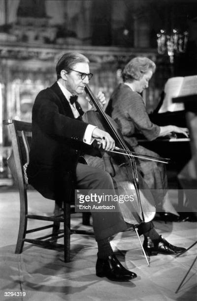 British conductor and cellist Sir John Barbirolli rehearsing for the King's Lynn Festival. Lady Ruth Fermoy is at the piano.