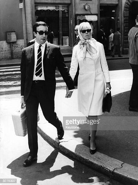 British comic actor Peter Sellers holding hands with his wife Swedish actress Britt Ekland whilst out shopping together in Rome