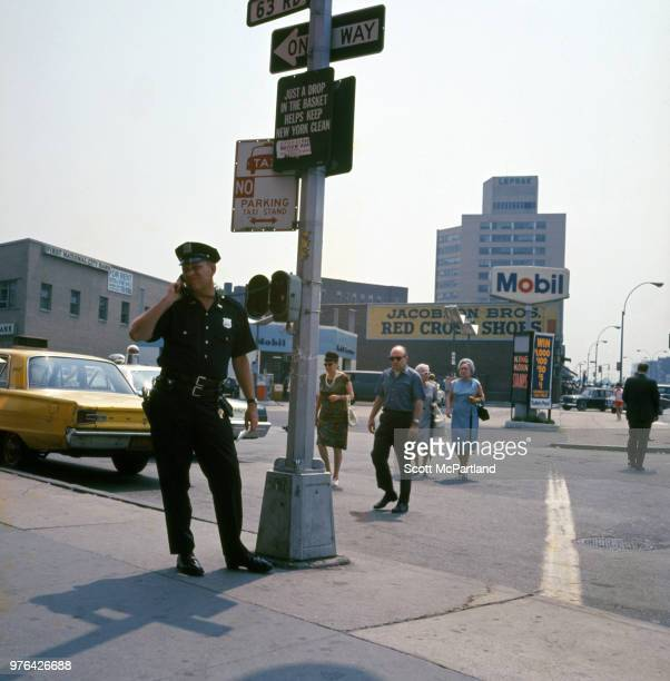 New York City A police officer talk on the phone at a call box on an unspecified street corner in Queens New York