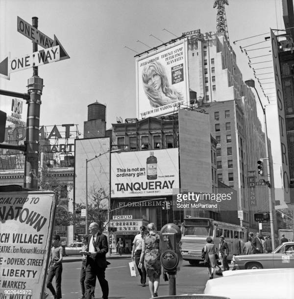 Pedestrians cross Seventh avenue and 47th street near the Edison hotel and Forum movie theater in the heart of Times Square New York