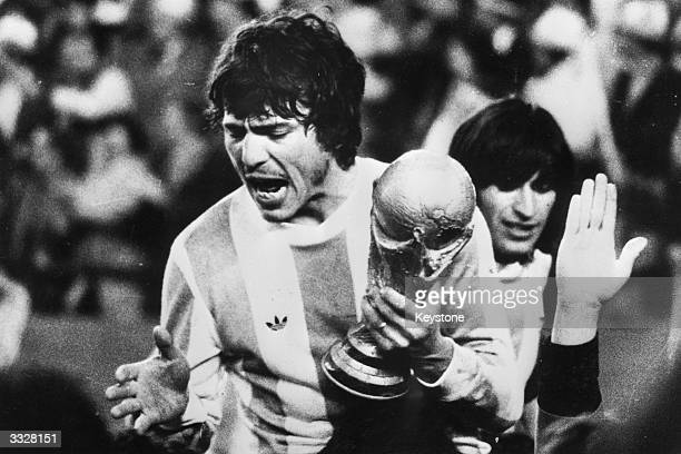 Captain of the Argentinian national football team Daniel Passarella with the World Cup trophy Argentina became World Champions with a 3 1 victory...