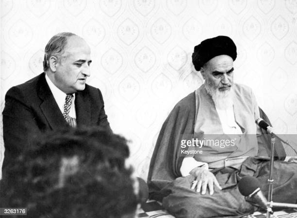 The new ruler of Iran Ayatollah Khomeini listens to the visiting Foreign Minister of Turkey Gunduz Okcun during a meeting at his residnce at Kum Iran