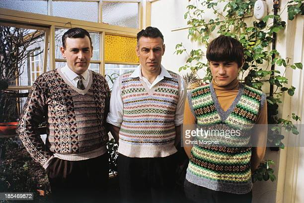 A boy and two men pose wearing Fair Isle jumpers and tank tops in the conservatory of a cottage on one of the Shetland Islands in June 1970