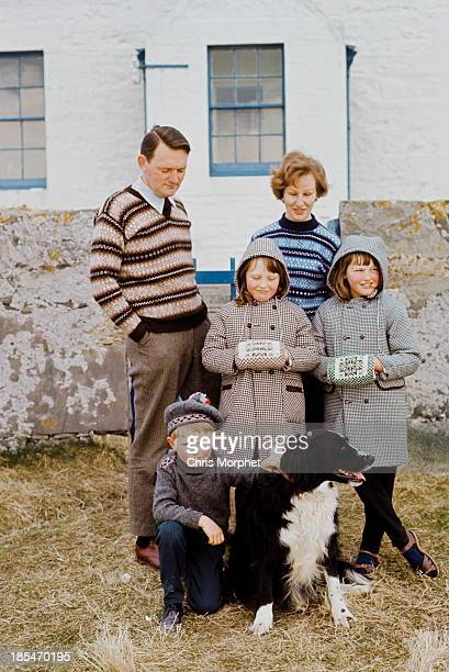 A family of Shetlanders pose wearing Fair Isle jumpers and coats on one of the Shetland Islands in June 1970
