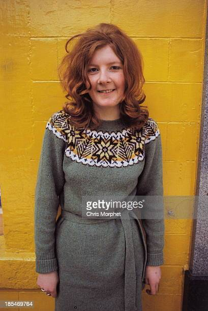 A young woman poses wearing a dress with Fair Isle style decoration around the collar in Lerwick Shetland Islands in June 1970