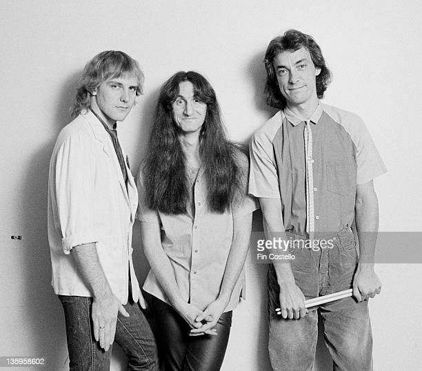 Alex Lifeson Geddy Lee and Neil Peart from Canadian rock band Rush pose backstage during their Permanent Waves tour of England in June 1980