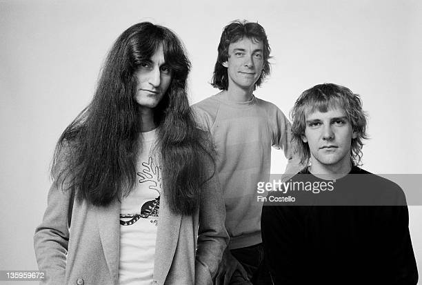 Bassist Geddy Lee drummer Neil Peart and guitarist Alex Lifeson from Canadian Progressive rock group Rush posed in London during the Permanent Waves...