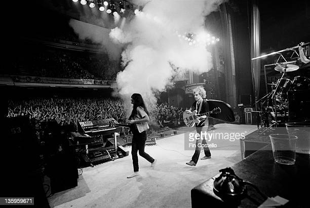 Canadian Progressive rock group Rush perform live on stage in front of an audience at London's Hammersmith Odeon during their Permanent Waves tour of...
