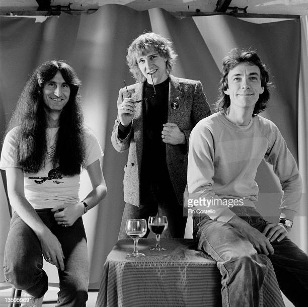 Canadian Progressive rock group Rush posed in a studio in London in June 1980 Left to right bassist Geddy Lee guitarist Alex Lifeson and drummer Neil...