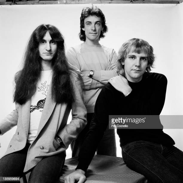 Canadian Progressive rock group Rush posed in a studio in London in June 1980 Left to right bassist Geddy Lee drummer Neil Peart and guitarist Alex...