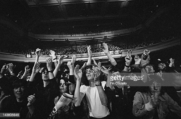 Fans and audience members watch Canadian Progressive rock group Rush perform live on stage during their Permanent Waves tour in England in June 1980