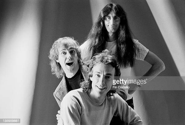 Guitarist Alex Lifeson Bassist Geddy Lee and drummer Neil Peart from Canadian Progressive rock group Rush posed in London during the Permanent Waves...