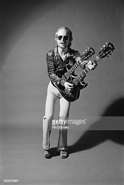 Guitarist Andy Powell from British rock band Wishbone Ash posed holding a Gibson EMS1235 Double Mandolin twin neck guitar in Westport Connecticut in...