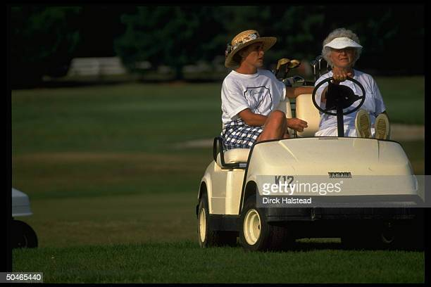 1st Lady Barbara Bush daughter Doro LeBlond watching poised jauntily in golf cart vacationing in Kennebunkport Maine