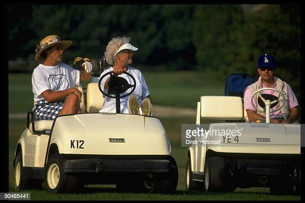 1st Lady Barbara Bush daughter Doro LeBlond watching poised jauntily in golf cart vacationing in Kennebunkport ME