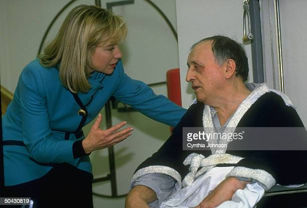 1st Lady Hillary Rodham Clinton chatting up patient in physical therapy unit of St Agnes Medical Ctr re her heading Pres's health care reform task...
