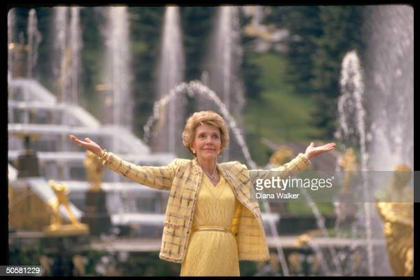 1st Lady Nancy Reagan standing in front of Samson Lion Fountain doing spot of sightseeing during Moscow summit