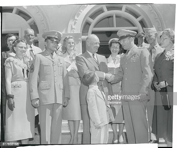 1st Lt Benjamin F Wilson of Vashon Washington right is congratulated by President Eisenhower after the Chief Executive presented Congressional Medals...