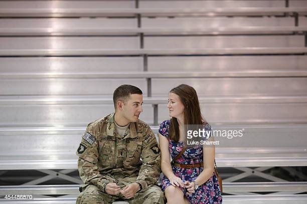 1st Lt Caleb Sandoval of the US Army's 159th Combat Aviation Brigade 101st Airborne Division sits with his wife Julia Bawden following a homecoming...