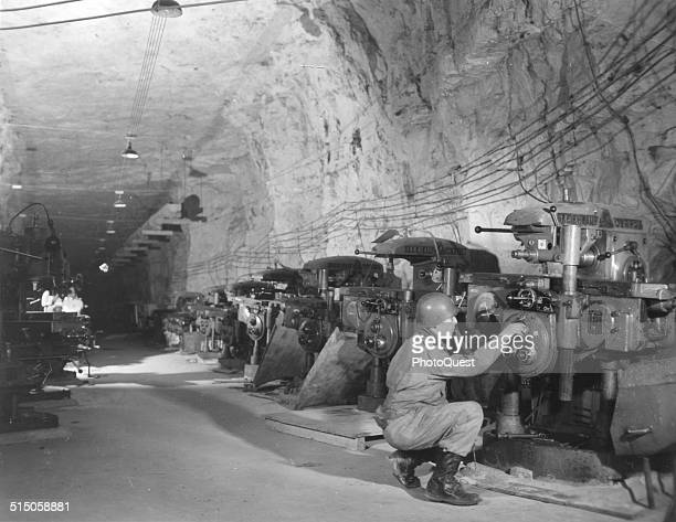 1st Lt Irwin Lieb looks over milling machines in a V1 factory located in an old iron mine Mine de Thil Thil France February 19 1945 8000 Todt workers...