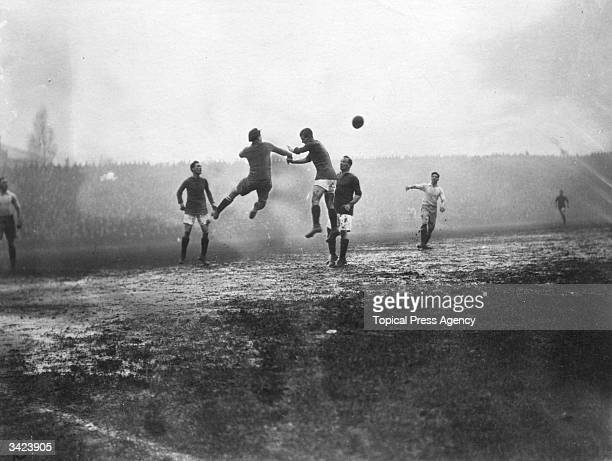 Players jump for the ball in a match between Arsenal and Preston North End at Highbury London