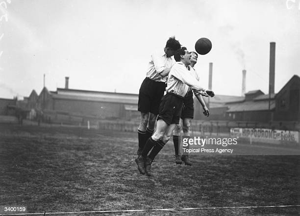 Derby County Football Club players Thomas McIntyre and Plackett compete for the ball in a training session