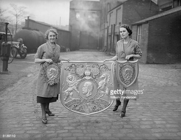 Commemorative shields painted by hand by workers in Darwen, Lancashire, for the King's Jubilee.