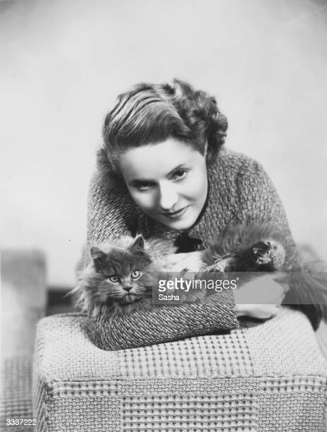 English film actress Ann Todd with a blue Persian cat she bought in Scotland