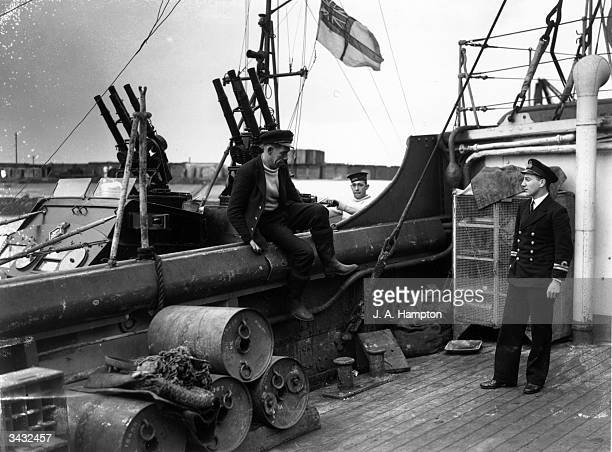 One of the crew of a motor torpedo boat climbs aboard a depot ship