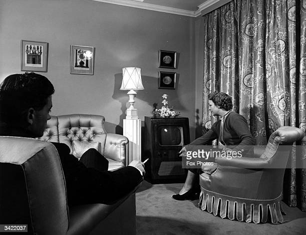 Londons first American hotel The Westbury Hotel London Couple sitting in a new hotel room