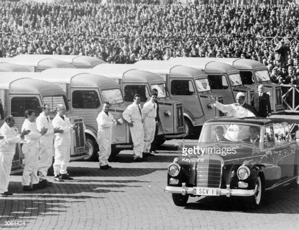 Pope Paul VI blessing lorries in St Peter's Square Rome before they are shipped to famine stricken areas of India