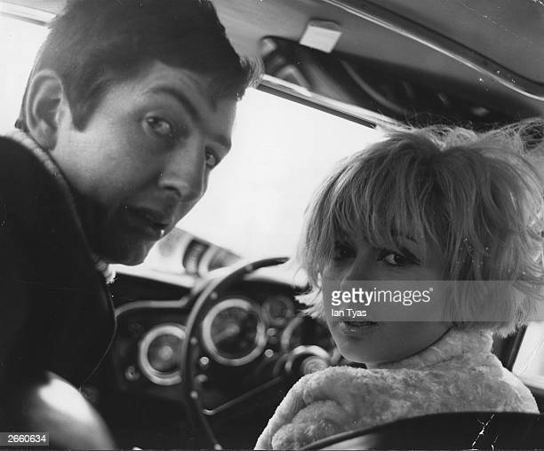 Actress Adrienne Posta in a car with Dave Cash during a driving lesson