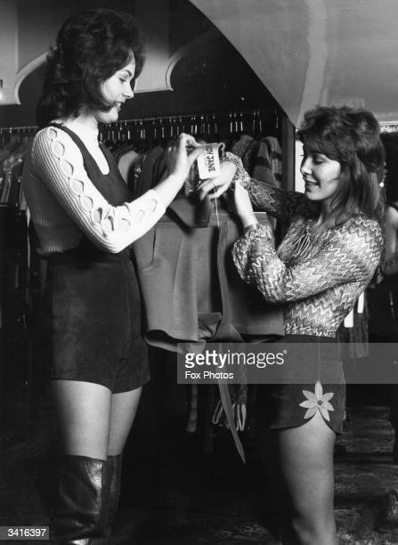 Hazel Noble and Frances O'Loughlin shop assistants at the 'Lady Jane' boutique in London's Carnaby Street examining a pair of hotpants
