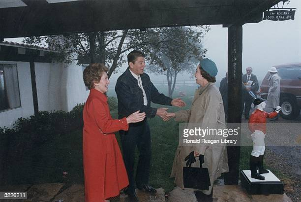 US president Ronald Reagan and First Lady Nancy Reagan welcome Queen Elizabeth II to their ranch at Rancho Del Cielo California Prince Philip...
