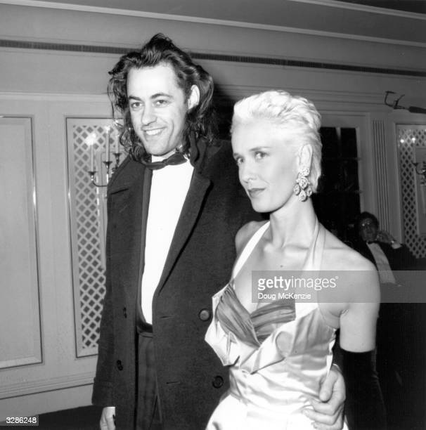 Bob Geldof formerly singer of new wave group the Boomtown Rats and his wife Paula Yates journalist and television presenter arrive for a social event