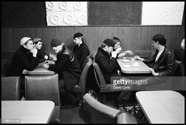 British group Dexys Midnight Runners pose in a cafe in Birmingham England in March 1980 Lead singer Kevin Rowland is sitting on the far right of the...