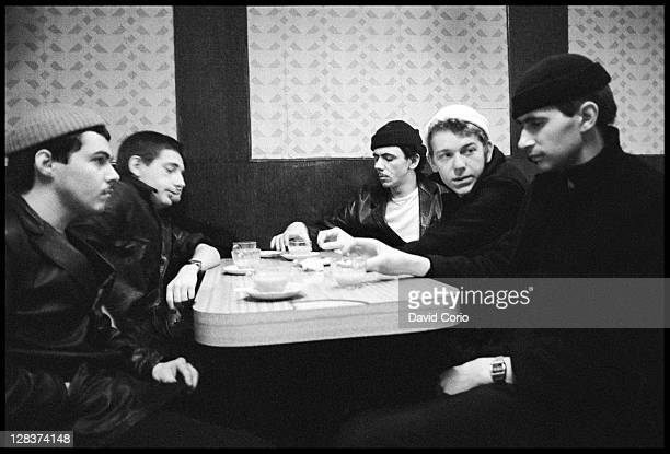 British group Dexys Midnight Runners pose in a cafe in Birmingham England in March 1980 Lead singer Kevin Rowland is sitting 3rd from right the group
