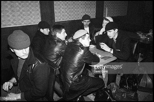 British group Dexys Midnight Runners pose in a cafe in Birmingham England in March 1980 Lead singer Kevin Rowland is sitting 3rd from right in the...