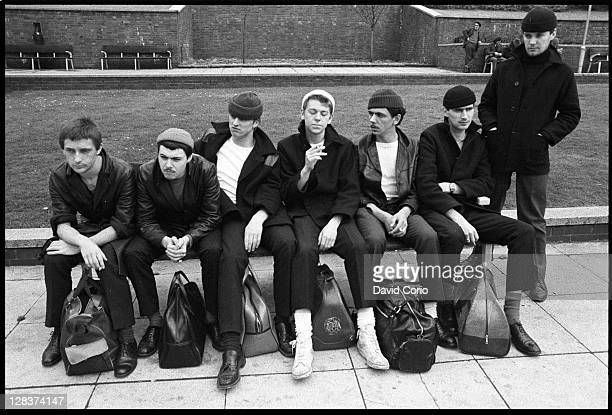 British group Dexys Midnight Runners pose on a bench in Birmingham England in March 1980 Lead singer Kevin Rowland is 3rd from right