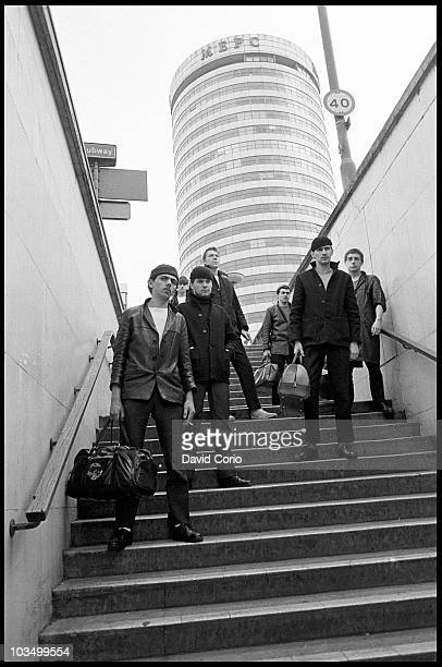 Dexys Midnight Runners pose for a group portrait with Kevin Rowland bottom left in front on the Rotunda in March 1980 in Birmingham United Kingdom