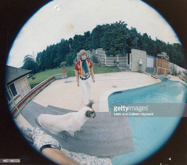 Fish eye view of Brian Jones from The Rolling Stones posed by George Harrison's swimming pool in Esher Surrey in March 1967