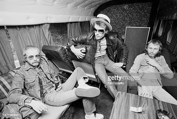 guitarist Andy Powell bass player Martin Turner and drummer Steve Upton from British rock group Wishbone Ash relax on a tour bus travelling between...