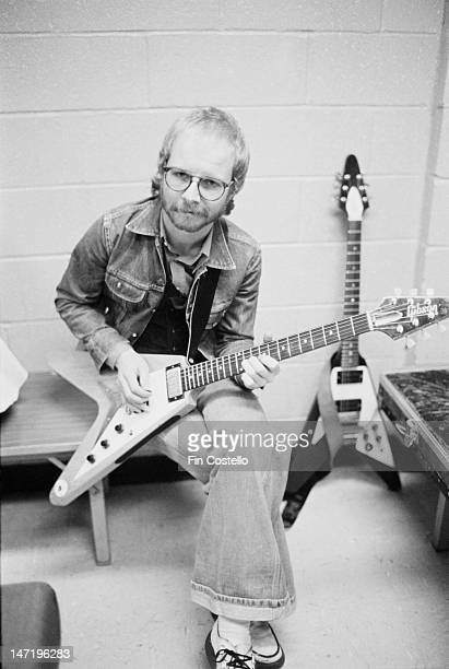 guitarist Andy Powell from British rock group Wishbone Ash posed holding a Gibson flying V guitar backstage during their tour of the United States in...