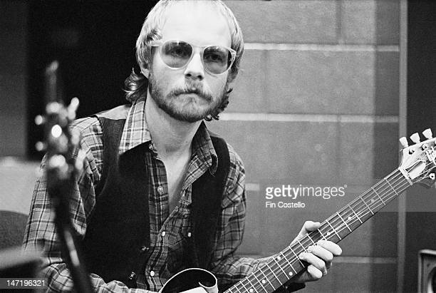 guitarist Andy Powell from British rock group Wishbone Ash posed holding a guitar backstage during the band's tour of the United States in March 1976
