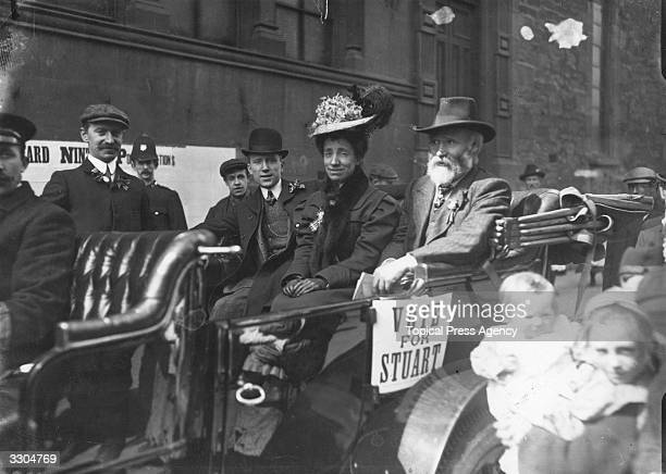 Scottish Labour leader James Keir Hardie , right, canvassing with the Labour candidate Mr Stuart, at election time. The woman in the carriage is Miss...