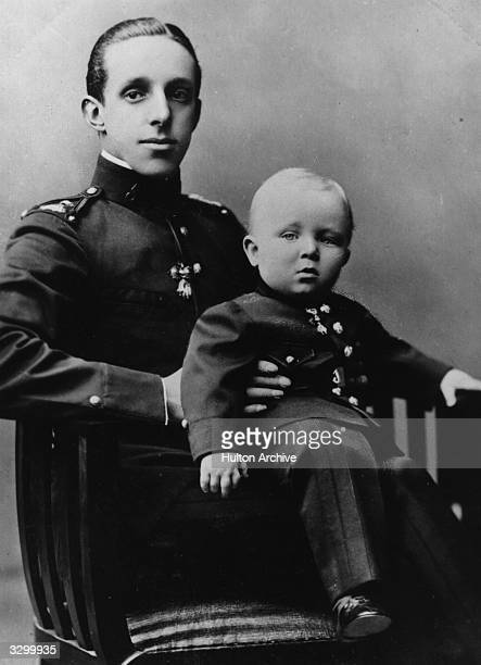 King Alfonso XIII of Spain with his eldest son and heir Alfonso Prince of Asturias The prince is wearing the uniform of a private in the King's...